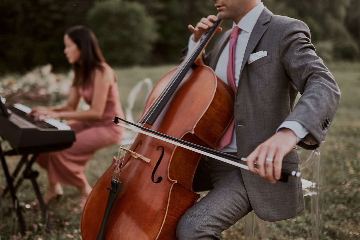 Brandon Wilkie Performing at Cottage Concert on Cello - Luxe Duo Music Ottawa - Cello and Piano - Wedding Musicians Corporate Events Private Concerts